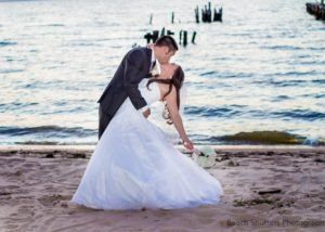 Beautiful couple in Wedding pose in Fairhope, Al taken by www.beachshutters.com