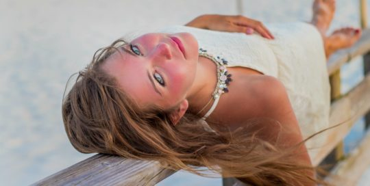 Pretty girl on boardwalk at the beach