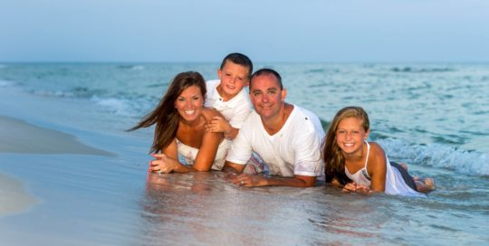 Family Photographer in Orange Beach or Gulf Shores photo in the water