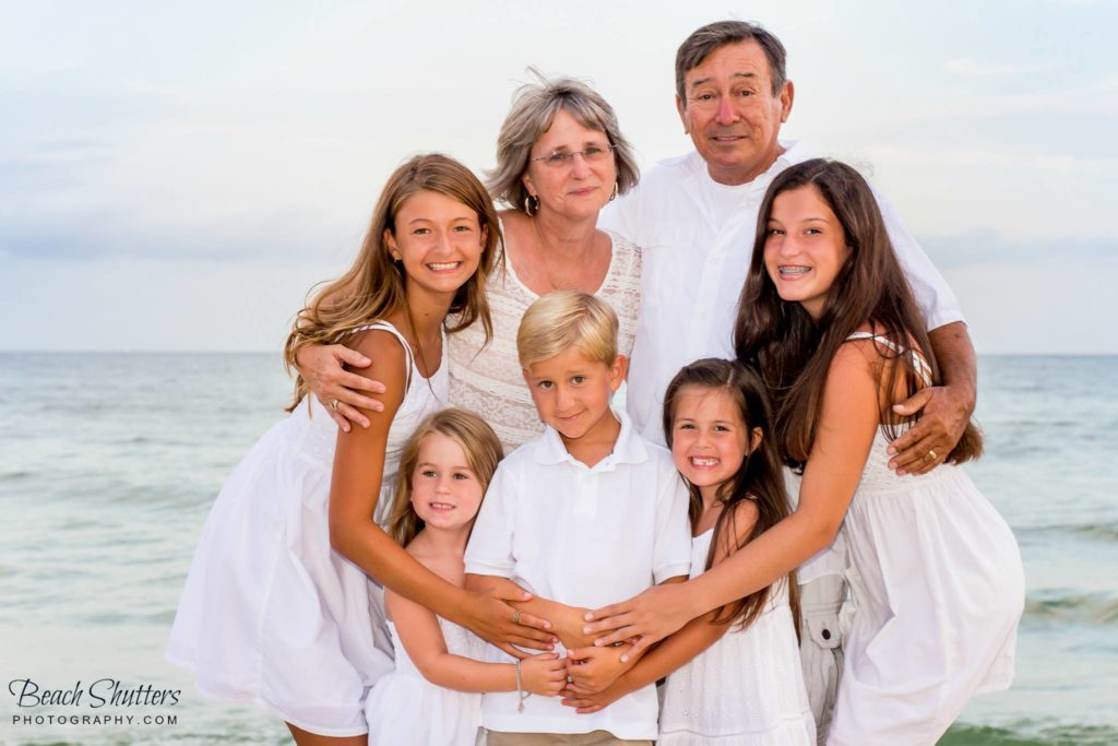 Proud grandparents and their grandchildren at the beach