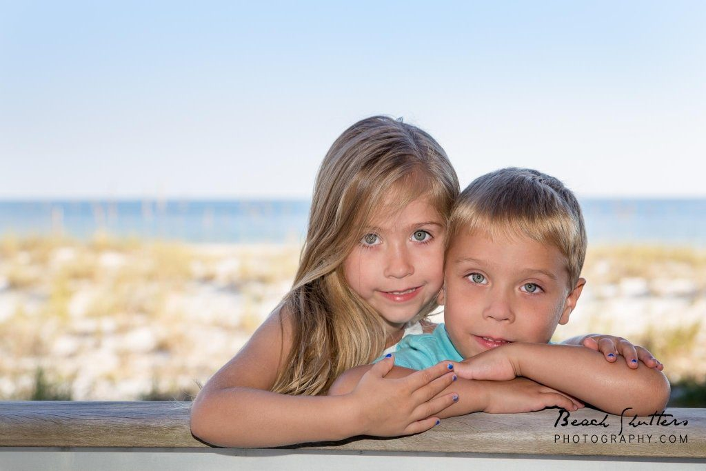 The twins keep a close eye on each other.. she makes sure he poses correctly for photos haha