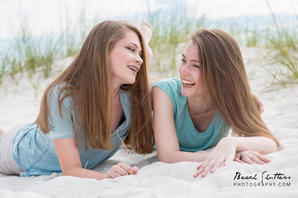 sisters having photos at the beach in Gulf Shores