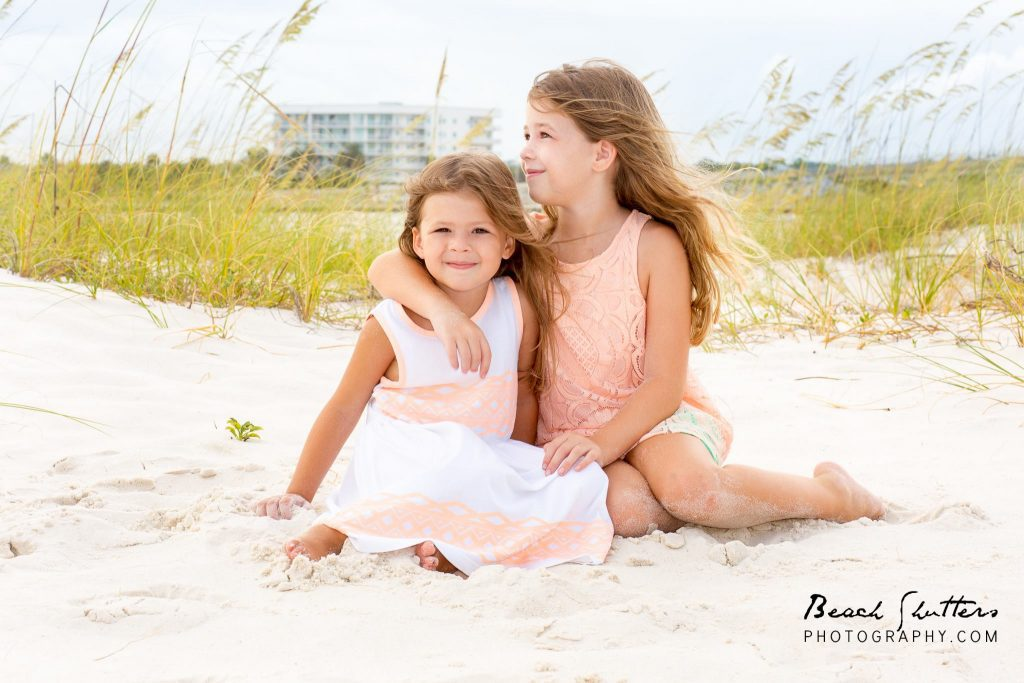 sisters at the beach having picture day