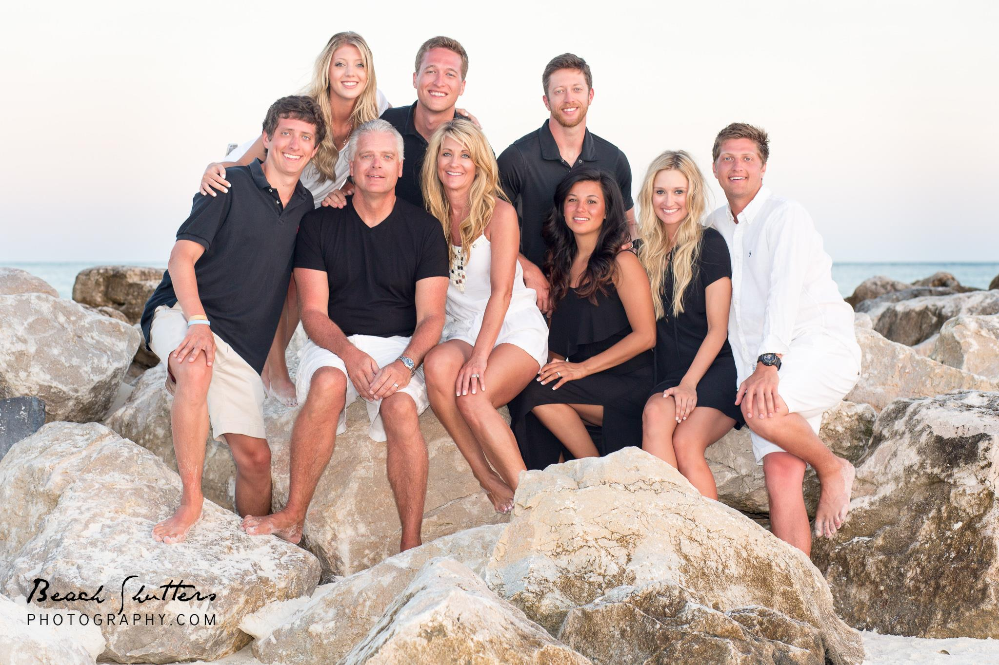 family modeling for photos at the beach in Orange Beach