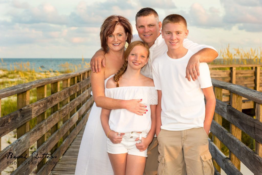 on the boardwalk at the Perdido Pass with the Family Photographer