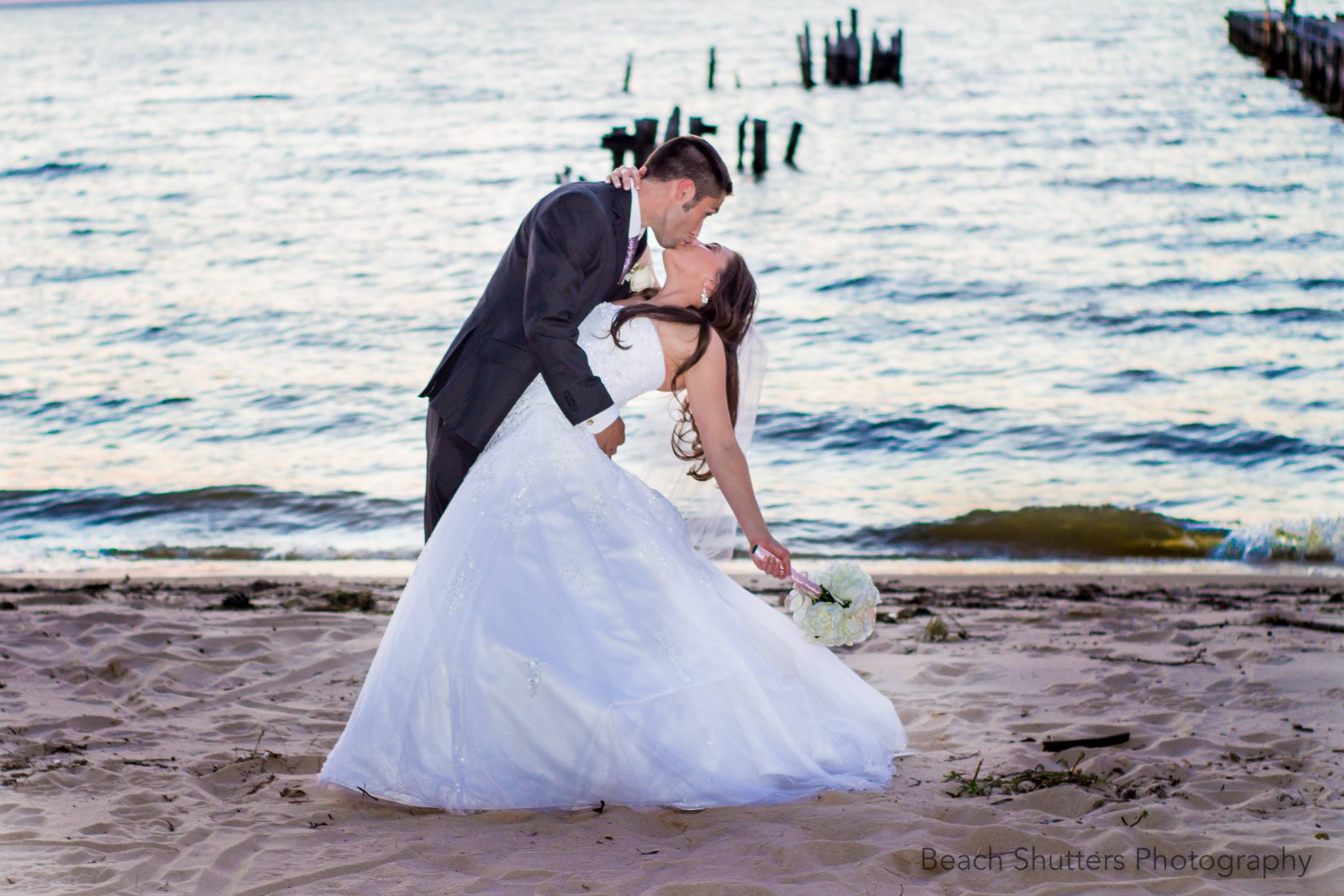 Beautiful couple in Wedding pose in Fairhope, Al taken by www.beachshutters.com
