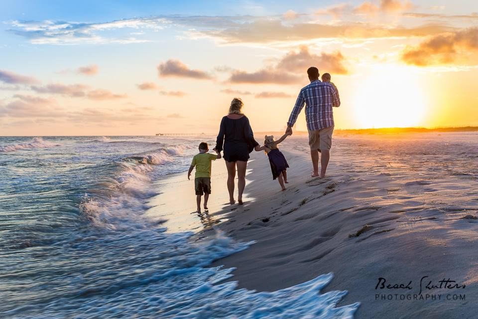 Booking page photo of a family walking into the sunset