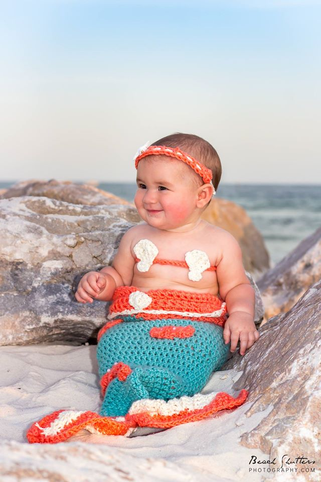 Her grandmom knitted this cute little costume for the baby.. we had to get photos at the beach!