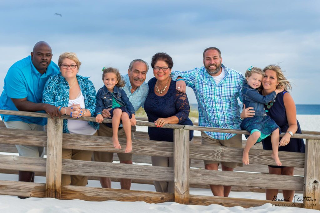 whole family on the boardwalk at the beach