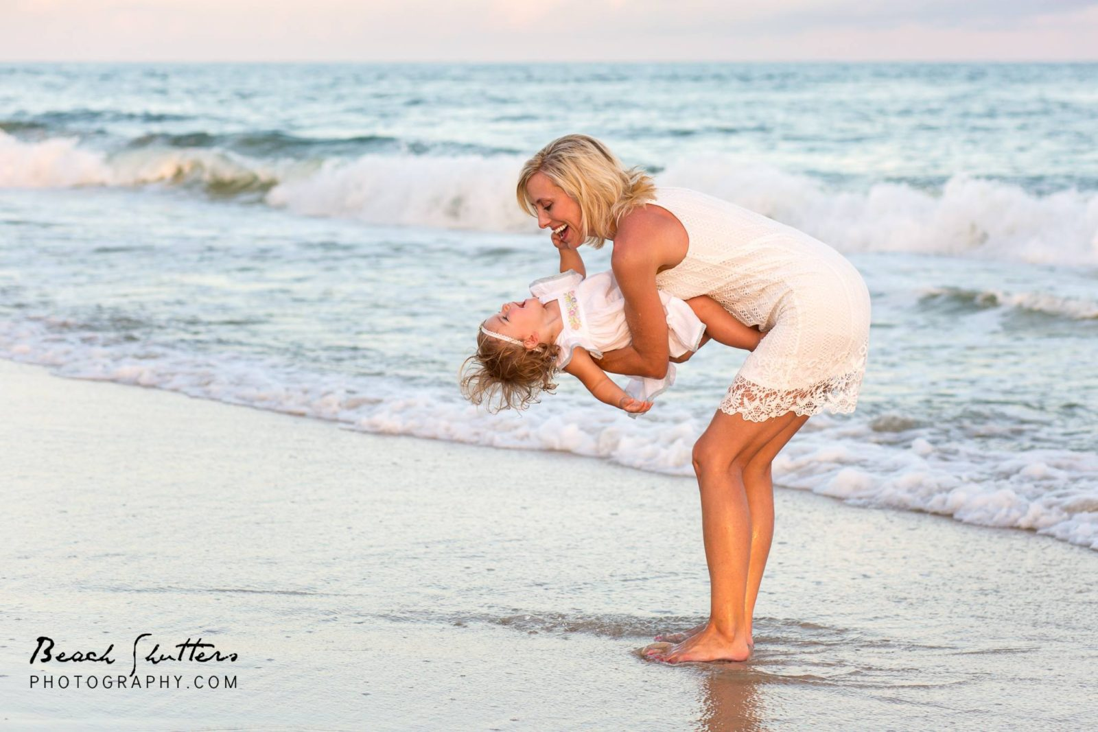 Family beach photography at Orange Beach of a grand mother and grandDaughter playing at the beach during our photo session