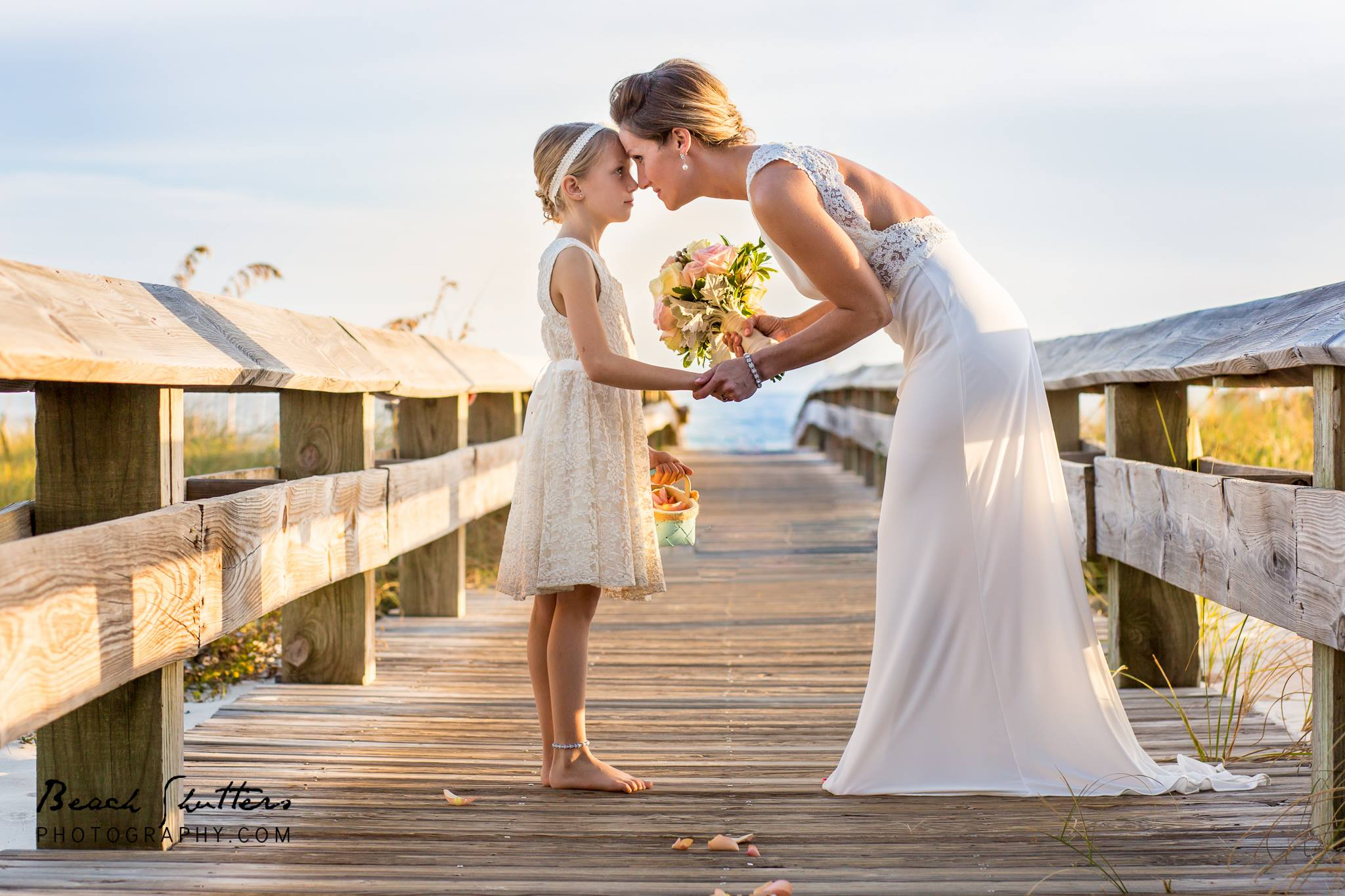Photography in Orange Beach at the boardwalk of condo wedding