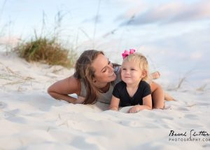candid photos of mom and daughter taken in Orange Beach