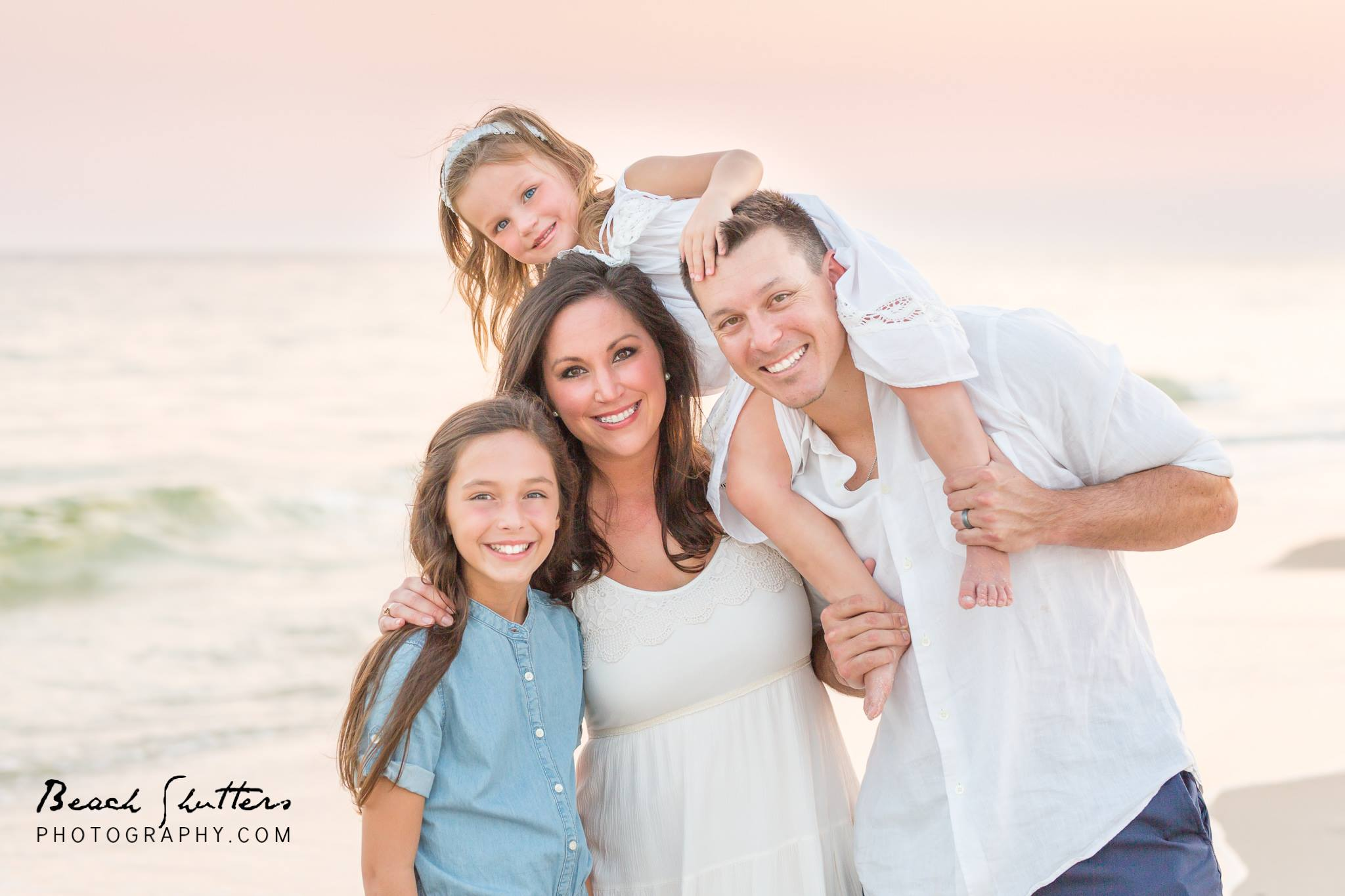 So you're thinking about taking family portraits while you're on vacation in Orange Beach. You are not alone.
