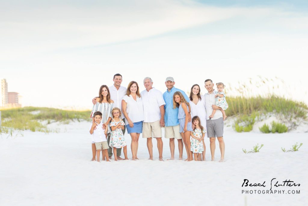 a family at the beach taking photos with an Orange Beach photographer